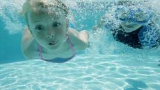 124816944 Boy And Girl Swimming