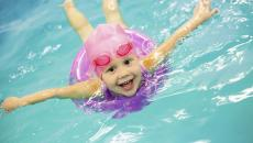 160892303 Little Girl Swimming In Pool