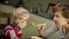 177844128(1) Mom Feeding Boy