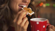 456033241 Woman Eating Christmas Cookie