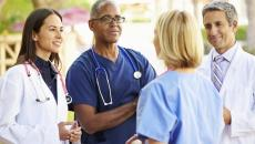 Thinkstockphotos 465134963 Medical Team Having Discussion Outside