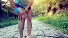 Thinkstockphotos 481917502 Woman Runner Holding Injured Knee