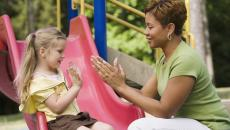 Thinkstockphotos 86536221 Woman Playing With Girl At Playground