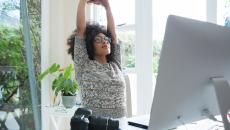 Thinkstockphotos 872926970 Girl Stretching At Desk