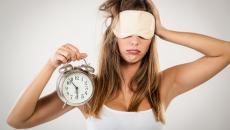 Lack Of Sleep Woman With Alarm Clock Small 508289462