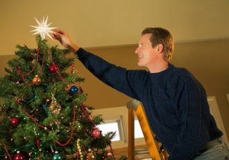 78029656 Holiday Decorating On Ladder