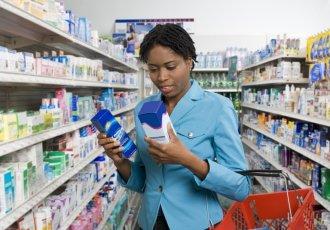 78056472 Woman Looking At Medication Boxes