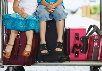 78743539 Boy And Girl On Luggage Cart
