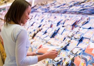 84462595 Woman Shopping For Fish