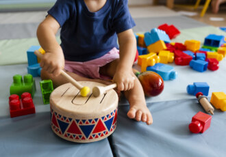 Child with Blocks and Music