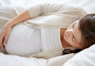 Getty Images 865692168 Sleeping Pregnant