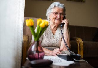 Happy elderly woman on phone