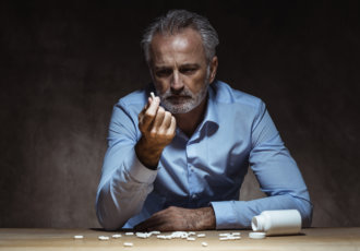 Man with drugs Getty Images 1024106306