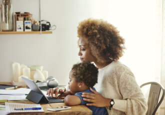 Mom looking at computer with Child