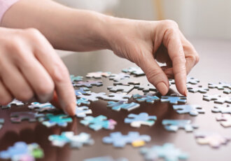 Puzzle pieces with hands
