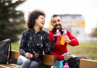 Runners drinking sports drinks
