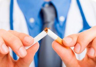 Thinkstockphotos 177543274 Physician Breaking Cigarette