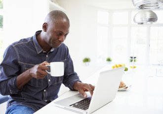 Thinkstockphotos 461259789 Man Using Laptop At Home
