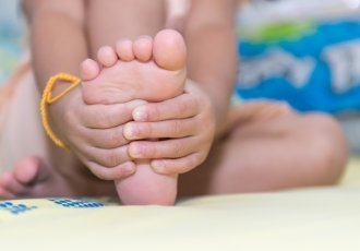 Thinkstockphotos 472840686 (1) Baby Massaging Feet