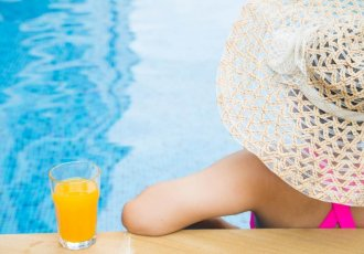 Thinkstockphotos 487320338 Woman Poolside With Hat And Juice Scaled