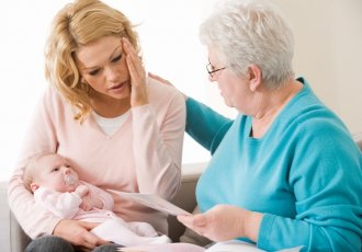 Thinkstockphotos 80403546(2) Mother Concerned Holding Baby