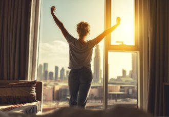 Thinkstockphotos 912257262 Woman Stretching Morning Window