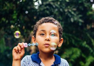 Boy blowing bubbles 2