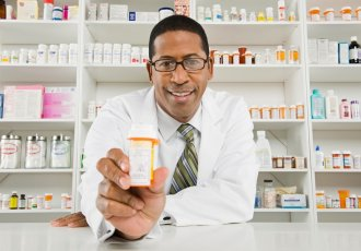 Pharmacist With Pill Bottle Scaled 2