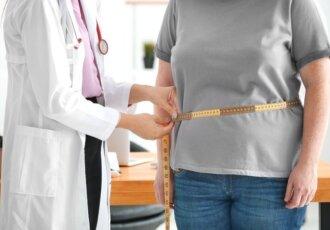 Provider measuring patients waist