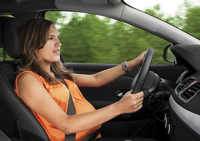 154380689 Pregnant Woman Driving Car