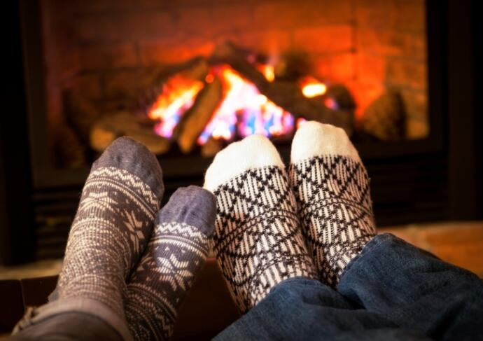 176623353 Feet Warming By Fireplace