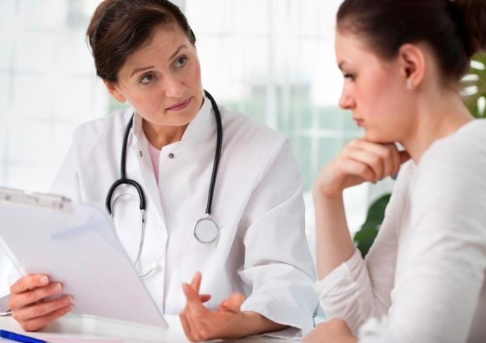 177445777 Physician Speaking With Female Patient