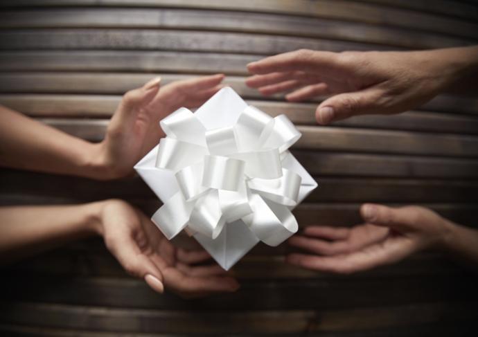 459273209 Hands Exchanging Present