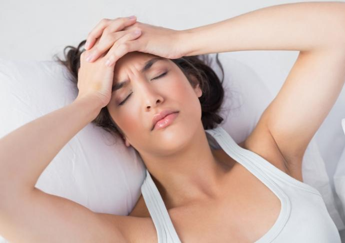 479680723 Woman With Headache In Bed