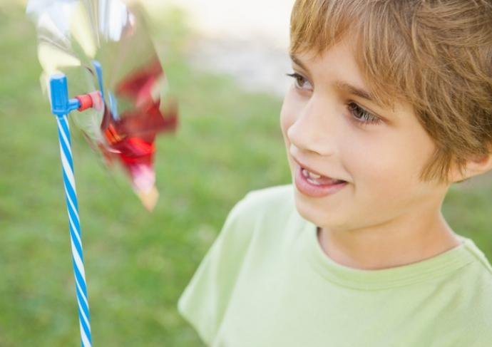 494377945 Boy Looking At Pinwheel