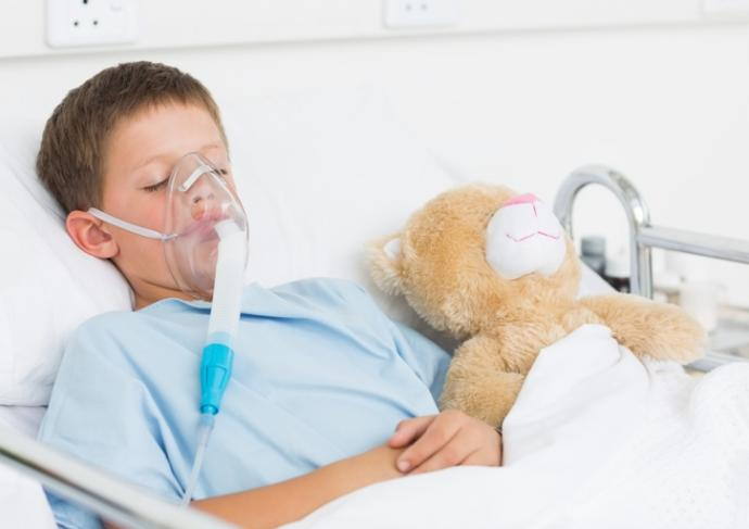 494386711 Boy Wearing Oxygen Mask In Hospital