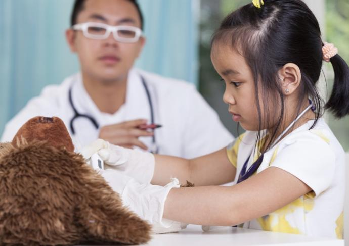 504738333 Girl In Peds Office With Teddy Bear