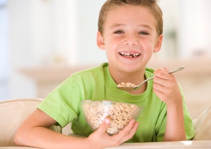 84468409 Boy Eating Cereal