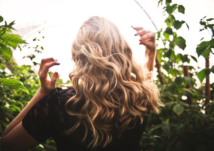 Blonde woman with long healthy hair