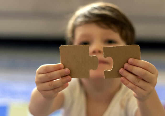 Boy with puzzle pieces autism