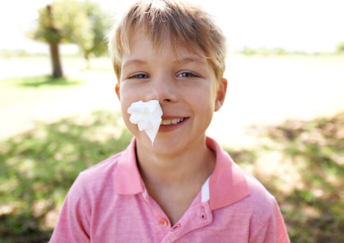 Boy with tissue in nose