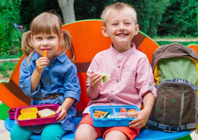 Children eating healthy lunchbox
