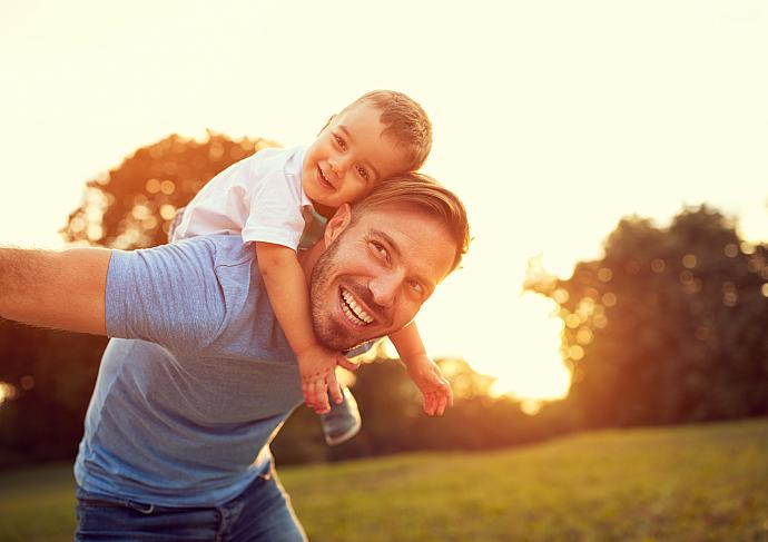 Gettyimages 672387490 Dad Piggybacking Son
