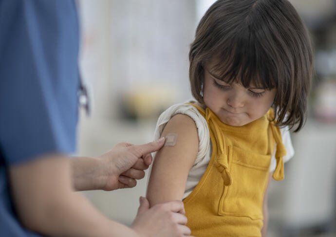 Girl getting vaccination