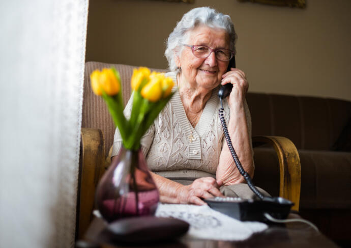 Happy elderly woman on phone