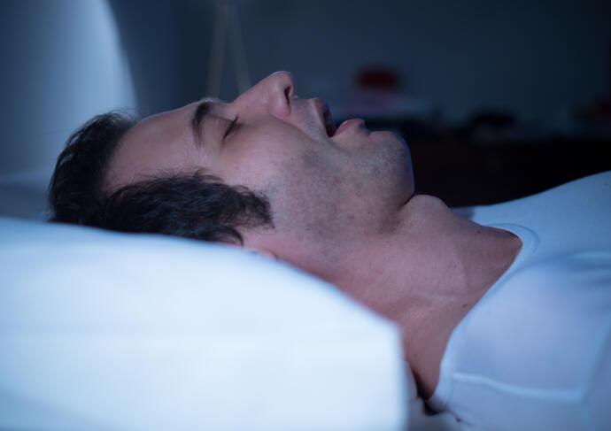 Man sleeping sleep apnea