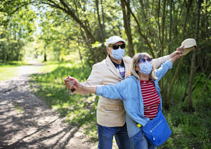 Older couple outdoors with mask on
