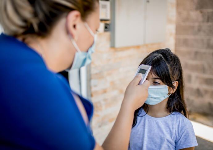 School nurse checking temp