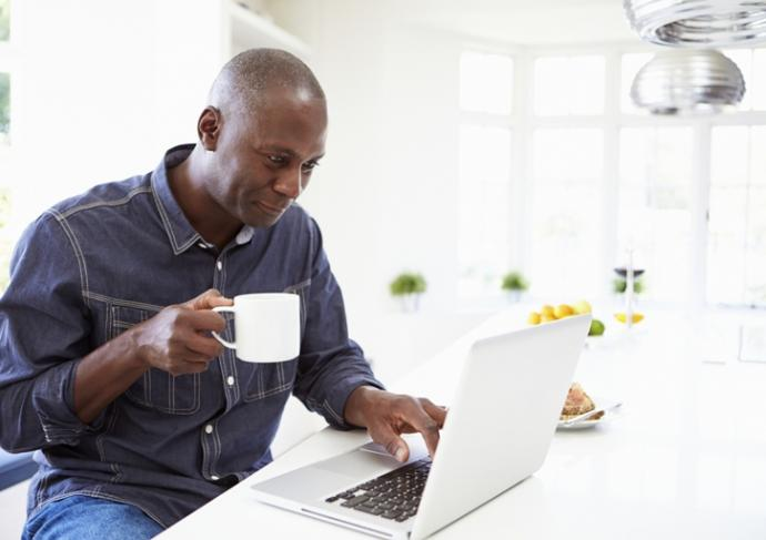 Thinkstockphotos 461259789 Man Using Laptop At Home