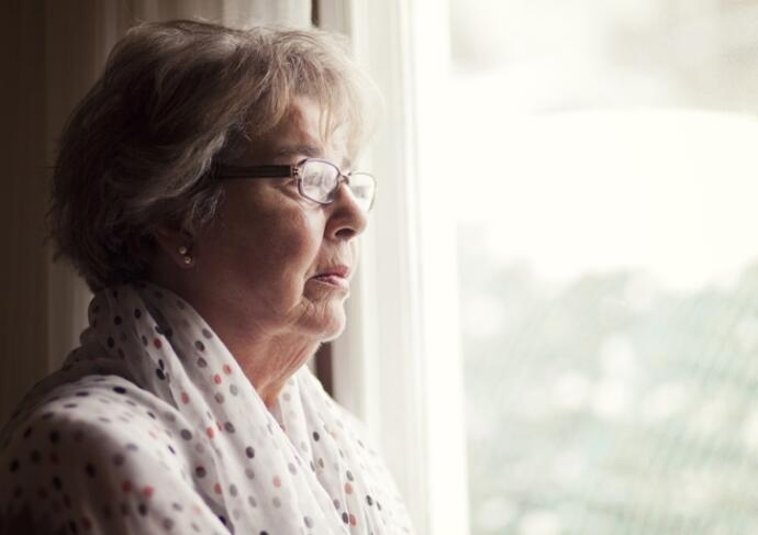 Thinkstockphotos 496352559 Senior Woman Looking Out Window